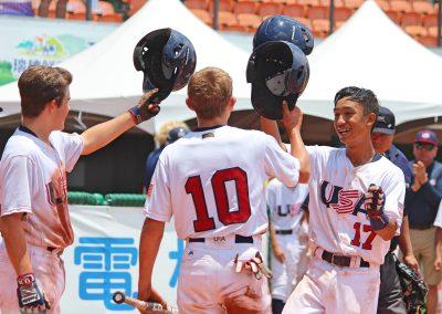20170805 U-12 Baseball World Cup Atomanczyk (left) Reiland (10) Caranto (17) USA celebrate homer run vs Mexico