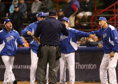 20170909 U-18 Baseball World Cup Italy coaching staff discuss with umpire (James Mirabelli-WBSC)
