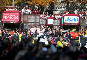 Japan's baseball league champions celebrate in streets with 214,000 fans during victory parade