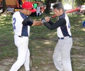 Baseball players in Malaysia carry on training